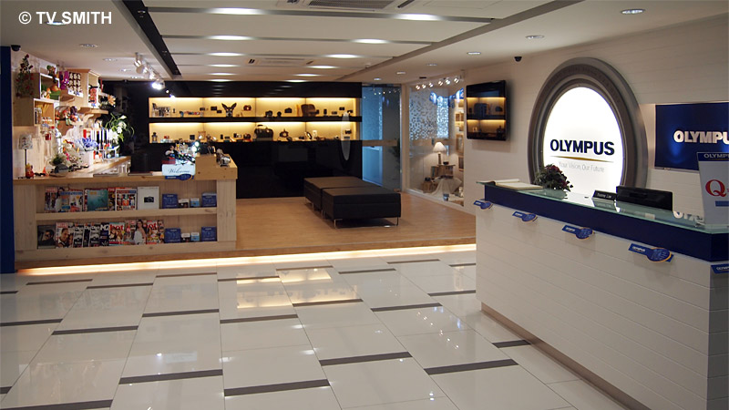 Lobby with reception, service counter and product display corner