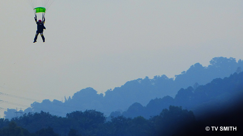 I like how the UV haze turned the distant hills bluish. The AF tracked the off-center sky diver very well