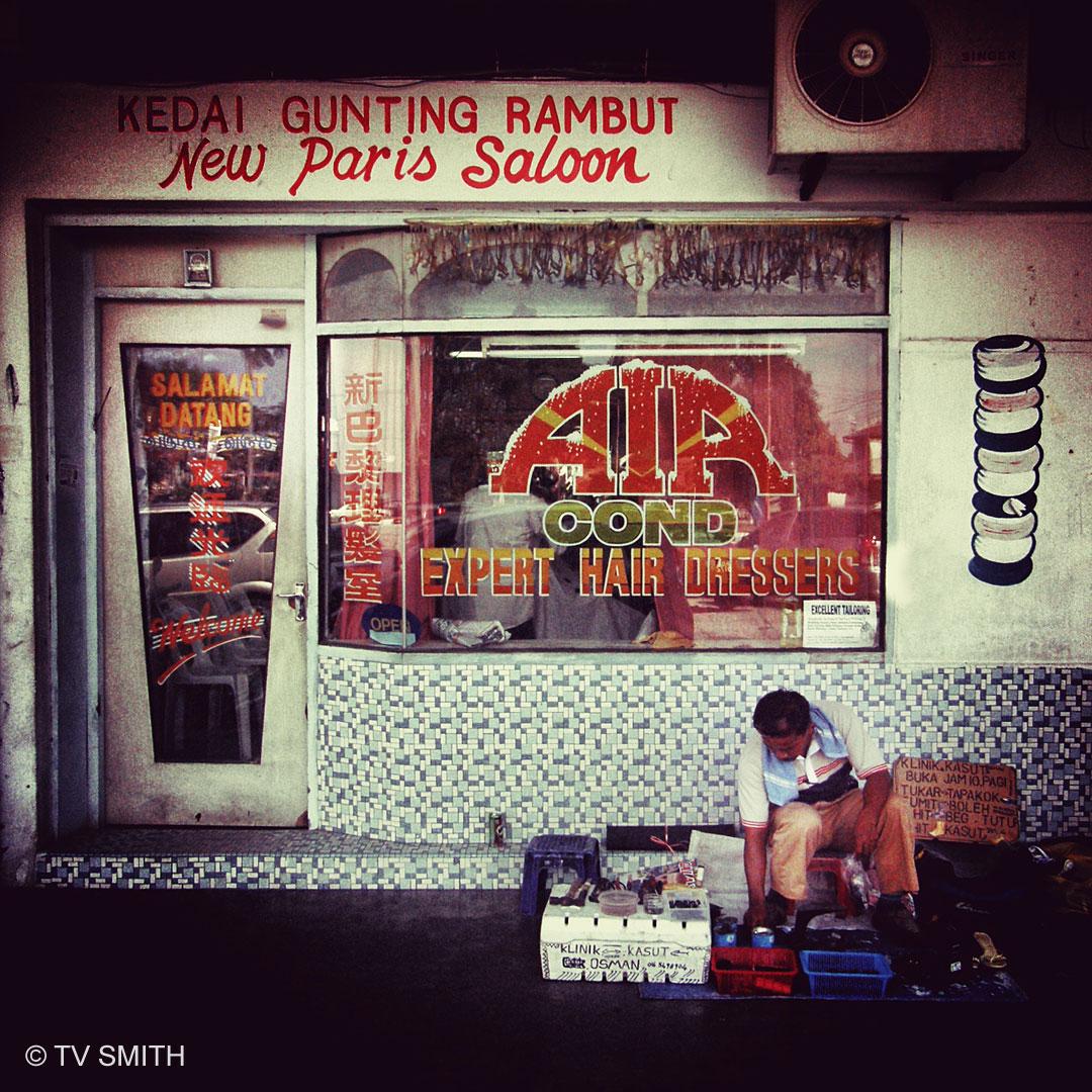 Barber and street cobbler in Ipoh Garden, Ipoh, Perak (circa 2008)